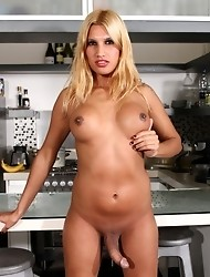 Seductive TS Vanuchi stripping in the kitchen