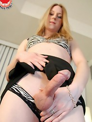 Eva Winters returns today to Canada TGirl and believe it or not, but this sexy   t-girl is here to usher in the summer heat!
