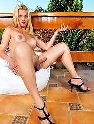 Busty Samara de Macedo posing her huge tits and cock