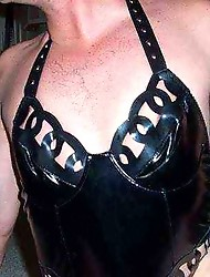 Crossdresser plays with cock and wears leather panties with corset