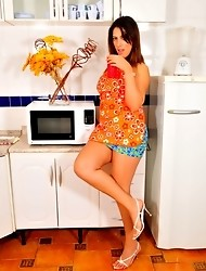 Super hot TS housemaid Patricia stripping in the kitchen