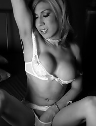 Busty tgirl playing with herself in bed