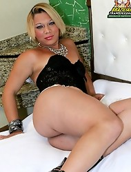 Horny blonde Latina with a big shecock!