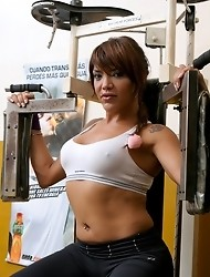Beautiful shemale Belen masturbating in the gym