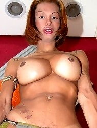 t-girl Pornstar Samantha di Piacci licking her own huge nasty injected silicon boobs