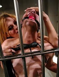 Hot Shemale fucks guy inside a jail cell and cums in his face