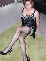 Sexy sophisticated tranny sipping a glass of wine and posing in a pair of nylon stockings