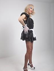 Sexy blonde crossdresser nurse showing off her tight body and pert ass